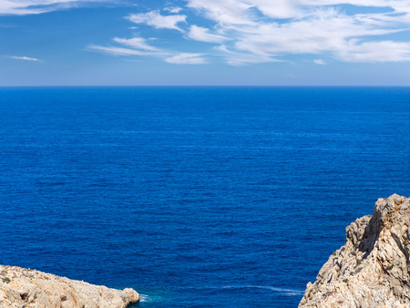 Beautiful blue sea and clouds - rocks in the foreground Reklamní fotografie