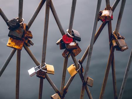 Love padlocks on locked on the railings on the bridge