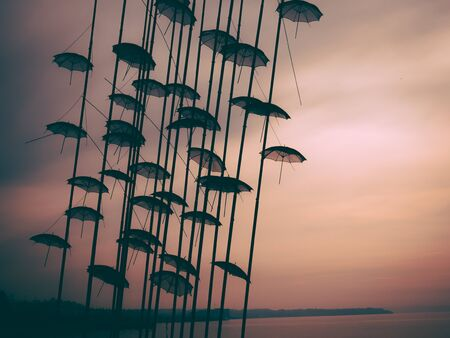 Umbrellas sculpture in a foggy sunset -  Thessaloniki, Greece