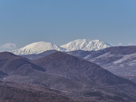 Snow covered peaks of the mountains in Greece 写真素材