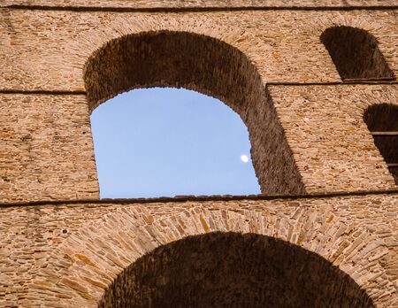 Detail of arcs and brickwork of stunning architecture - Ancient Roman aqueduct in Greece Stock Photo