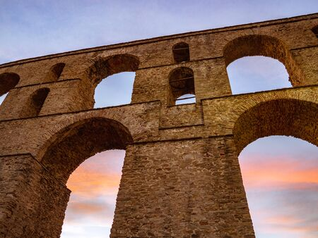 Ancient roman aqueduct in the sunset Stock Photo - 130121157