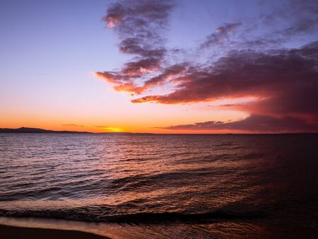 Moody sunset on a empty beach 写真素材 - 131702292