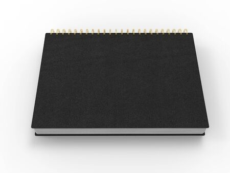 Black notebook with golden spiral binding and leather covers - top down side view