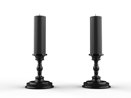 Two black wax candle on black candle holders