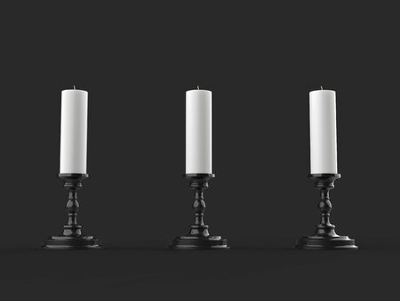 Three white wax candles on shiny black candleholders 写真素材