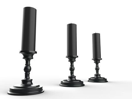 Three black wax candle on black candle holders - low angle shot