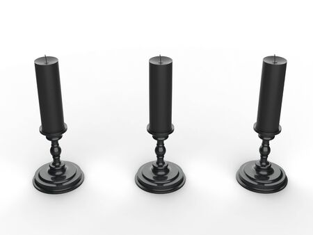 Three black wax candle on black candle holders - top down view