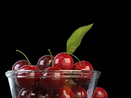 Fresh beautiful cherries in a glass bowl