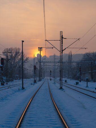 Empty train tracks at sunset - winter season