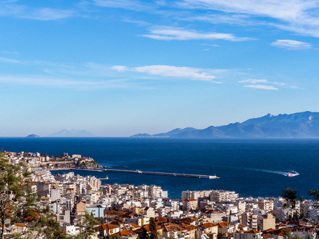 Overlook of the Kavala port and the Tassos island in the background Редакционное