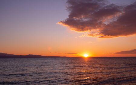 Beautiful sunset over the sea Фото со стока