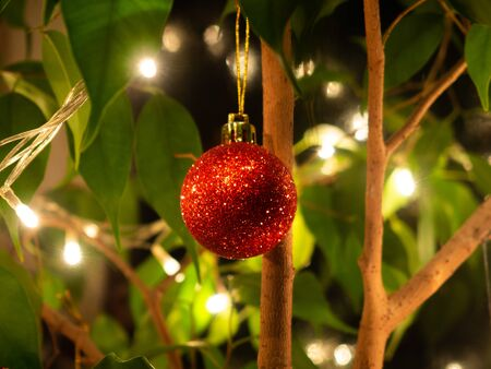 Small shiny glittering red Christmas bauble ornament