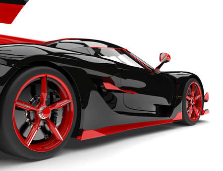 Black and red sports race super car - rear wheel closeup shot