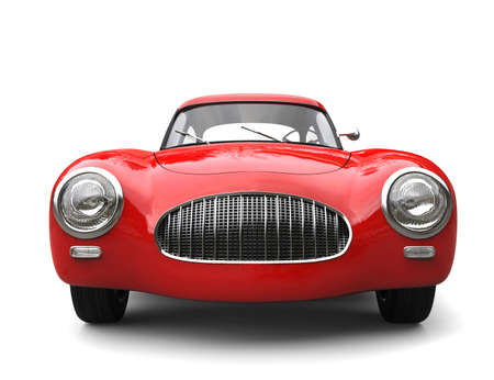Old vintage scarlet red sports car - front view closeup shot