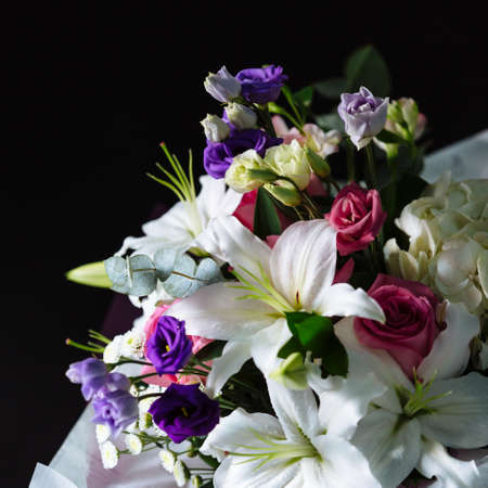 Bouquet of colorful flowers on dark background. Shallow depth of field and close-up.