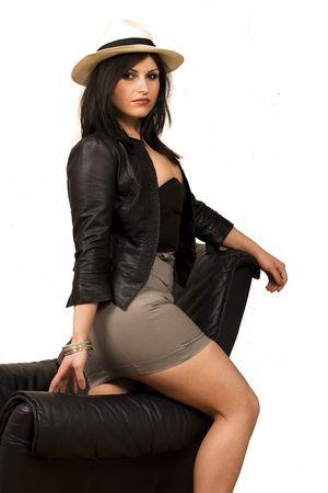 leather skirt: Female Model On Leather Sofa Stock Photo