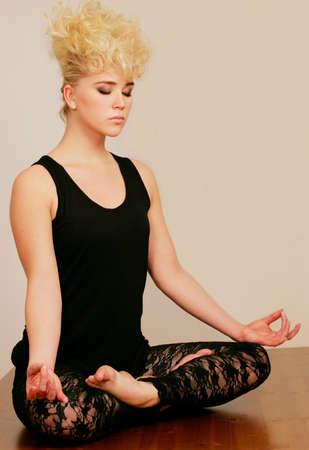 Modern female in yoga pose Stock Photo - 6868690