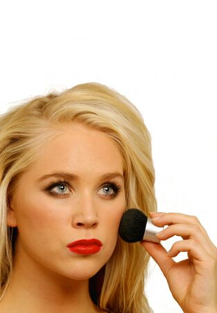 Girl doing face makeup, with copy space photo