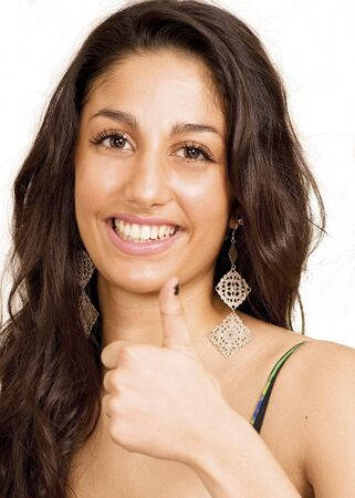 Smiling female showing thumbs up sign photo