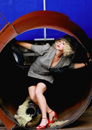 Retro fashion model posing in industrial pipe Stock Photo - 6869433
