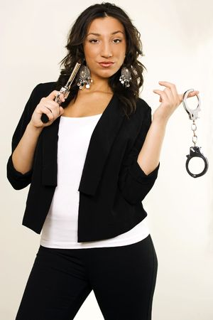 Cute female detective with gun and handcuffs photo