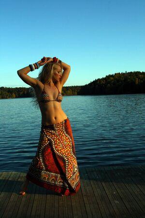 Sexy woman by lake at sunset Stock Photo - 6958127
