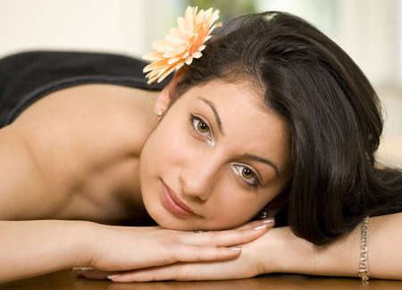 Young woman in spa or massage, face closeup photo