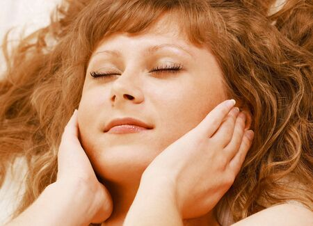 Reiki self-healing, female face with hands Stock Photo - 7113319