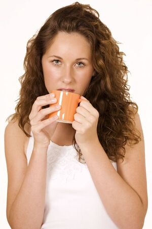 Beautiful girl drinking coffee, tired expression Stock Photo - 7538970