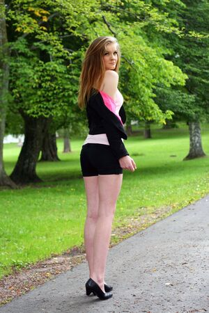 Trendy young woman on country road Stock Photo - 7594112