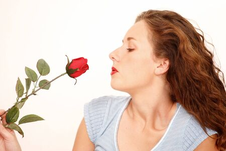 Pretty girl smelling rose Stock Photo - 7594108