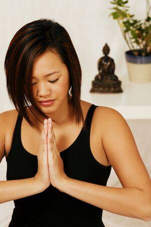 reverence: Martial arts girl at prayer meditation Stock Photo