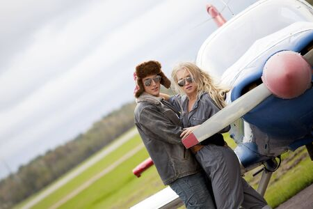 Trendy couple with private plane photo