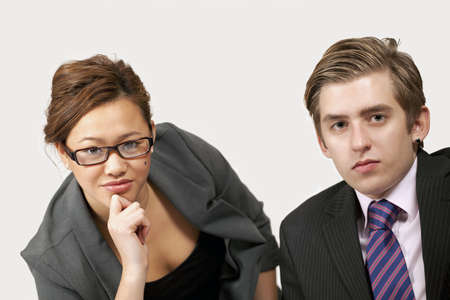 Young office workers listening with serious expression photo
