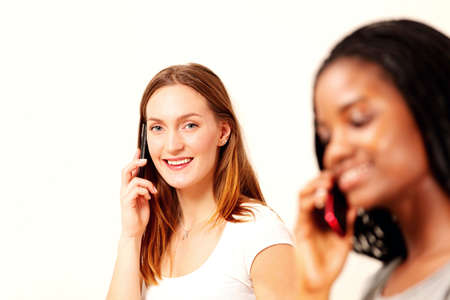 Girls on phone, bright horizontal composition with selective focus photo