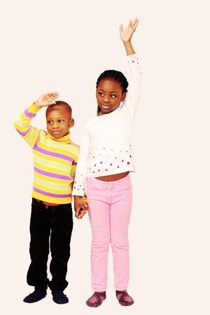 Two kids wave a sad farewell photo