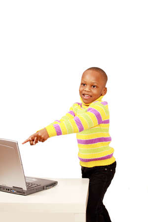 Happy excited kid pointing to computer photo