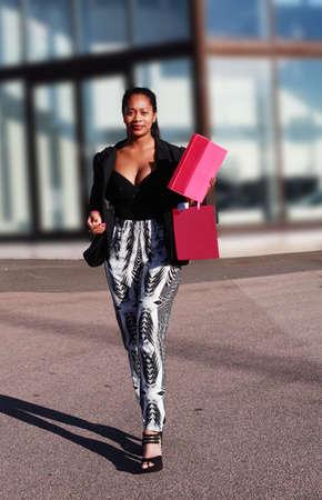 Female shopper leaving departmental store photo