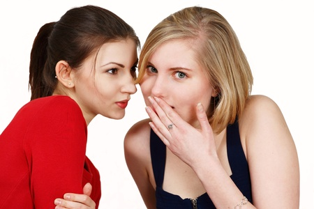 Two females share secret or gossip photo