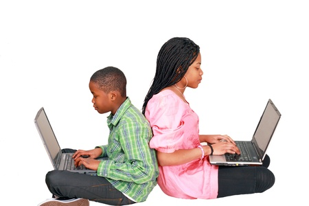 casuals: Two beautiful kids on laptop