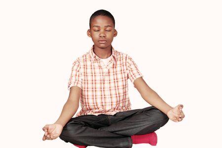 black kid: Ethnic youth yoga meditation pose