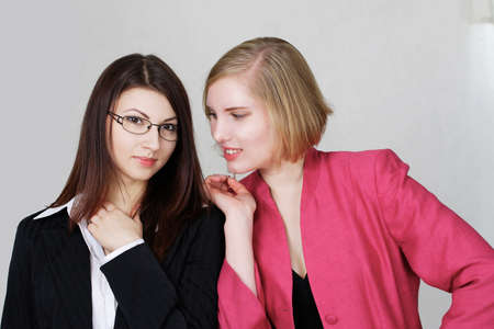 Pretty office girls chatting or social interaction at work photo