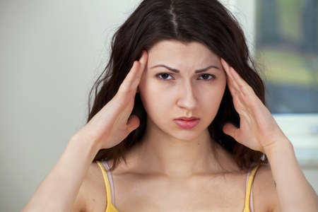 Girl with headache or stress Stock Photo - 9124074