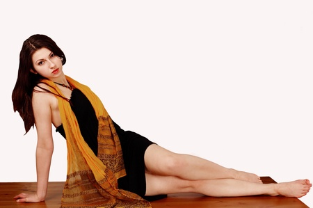 Pretty girl with scarf in horizontal full-length pose photo