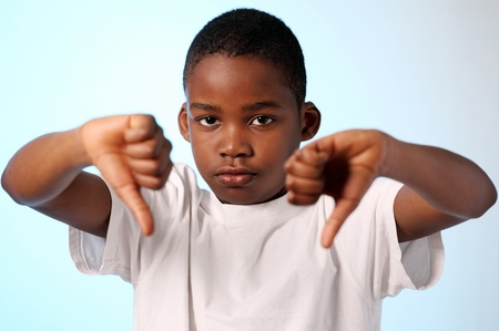 Boy making thumbs down gesture with both hands Stock Photo - 9246611