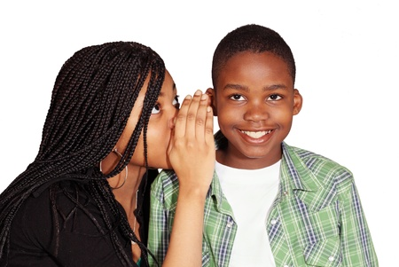 Kids sharing secret with grinning boy Stock Photo - 9246609