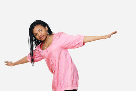 Girl with arms outstretched balancing or ready to fly Stock Photo - 9246613