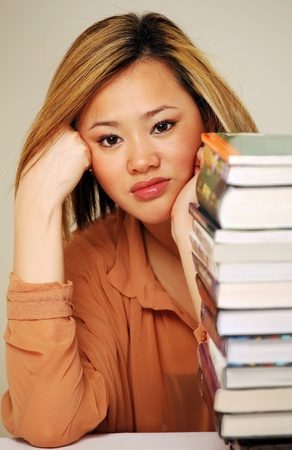 Pretty chinese student with books Stock Photo - 9304726