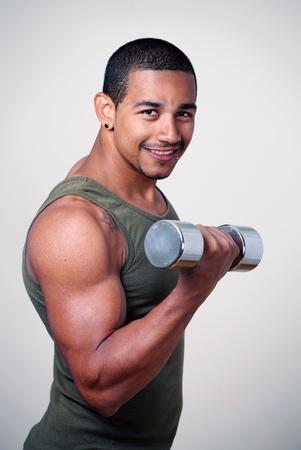 Tough smiling gym guy strength training photo
